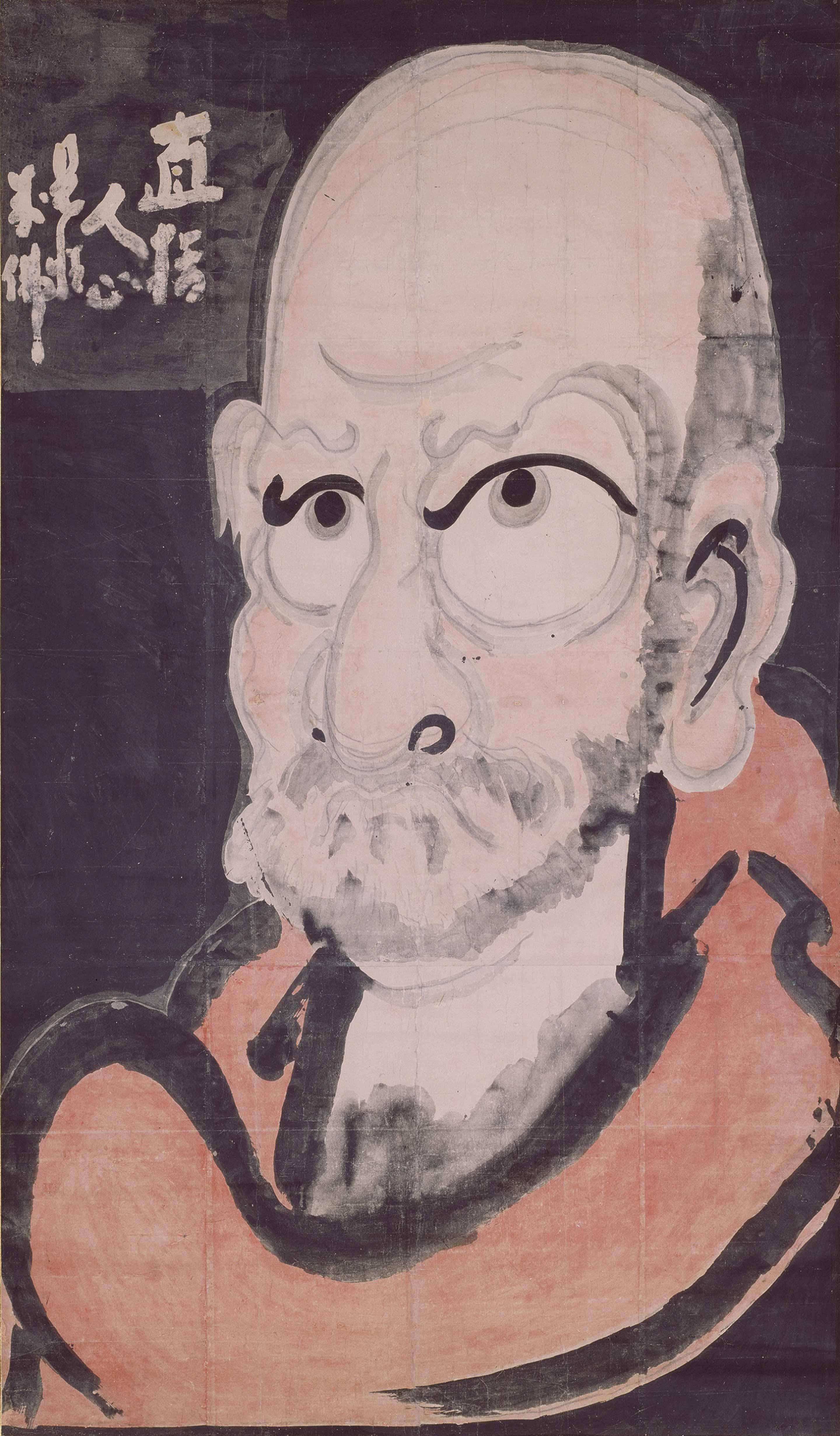 達磨像 白隠慧鶴筆 江戸時代 18世紀 大分・萬壽寺蔵 通期展示 白隠が描いた縦2メートル近い巨大な達磨像。白抜き文字は達磨の宗旨「直指人心 見性成仏」を示している。